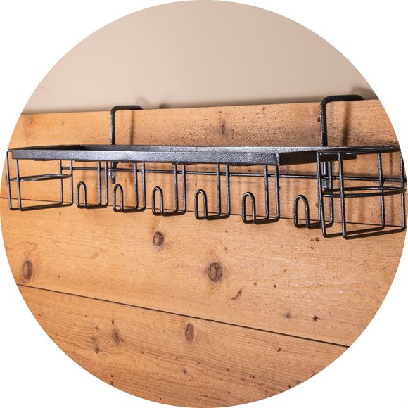This all-in-one shelf has it all with a long shelf, underneath tack hangers, and a bottle holder on each end designed to fit your every need.